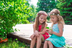Happy adorable girls enjoy summer day play in the Royalty Free Stock Images