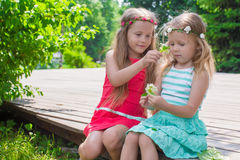 Happy adorable girls enjoy summer day play in the Royalty Free Stock Image