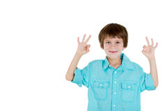 Happy adorable kid showing OK sign with two hands Royalty Free Stock Photos