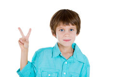 Happy adorable kid with a victory, peace sign Stock Image