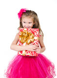 Happy adorable little girl with christmas gift box Stock Image