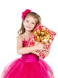 Happy adorable little girl with christmas gift box Stock Photography