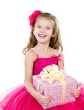 Happy adorable little girl with christmas gift box Royalty Free Stock Photos
