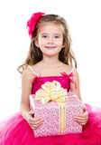 Happy adorable little girl with christmas gift box Stock Photography