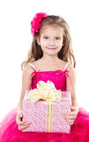 Happy adorable little girl with christmas gift box Stock Photos