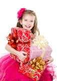 Happy adorable little girl with christmas gift boxes Royalty Free Stock Photography