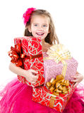 Happy adorable little girl with christmas gift boxes Royalty Free Stock Image