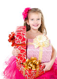 Happy adorable little girl with christmas gift boxes Stock Images