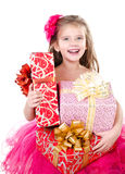 Happy adorable little girl with christmas gift boxes Royalty Free Stock Images