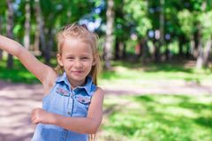 Happy adorable little girl enjoy summer day in the Royalty Free Stock Photos