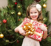 Happy adorable little girl with gift Royalty Free Stock Photography
