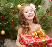 Happy adorable little girl with gift box Stock Images