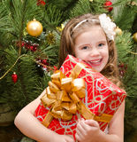 Happy adorable little girl with gift box Stock Photography