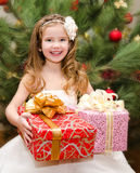 Happy adorable little girl with gift boxes Stock Photos
