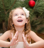 Happy adorable little girl near christmas tree Royalty Free Stock Images