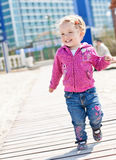 Happy adorable little girl running Stock Images