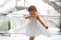 Cute Asian girl dancing royalty free stock photos