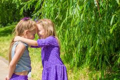 Happy adorable little girls enjoy summer day in Royalty Free Stock Photography