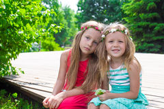 Happy adorable little girls enjoying warm summer Stock Images
