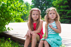 Happy adorable little girls enjoying warm summer Royalty Free Stock Photos