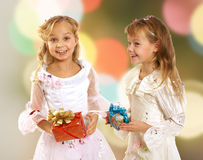 Happy adorable little girls with gift Royalty Free Stock Image