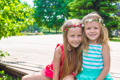 Happy adorable little girls on warm summer day Stock Image