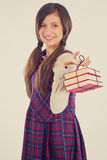 Happy adorable student  holding a pile of books Royalty Free Stock Photo