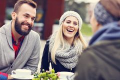 Happy adult couple dating in cafe. Picture showing happy adult couple dating in cafe stock image