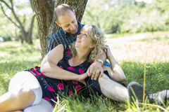Happy adult couple in park. A Happy adult couple in park having fun royalty free stock photo