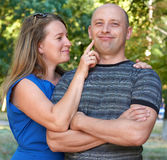 Happy adult couple posing, woman touch man face, romantic people concept, summer season, emotion and feeling. Happy adult couple posing, women touch men face stock image