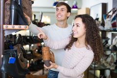Happy adult couple shopping at shoe store Royalty Free Stock Images
