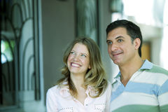 Happy adult couple. Smiling outdoors royalty free stock image