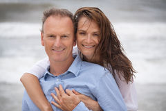 Happy adult couple in summertime on beach Royalty Free Stock Photography