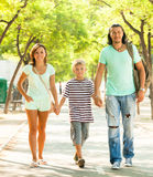 Happy adult couple with teenager. Enjoying time in summer park stock images