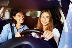 Happy Adult Daughter Driving Her Mother In Car Stock Photo