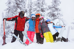 Happy adult friends skiers winter Royalty Free Stock Image