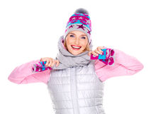Happy adult girl in winter clothes with bright positive emotions Royalty Free Stock Photo