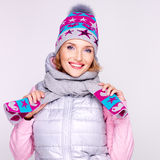 Happy adult girl in winter clothes with bright positive emotions Stock Photos