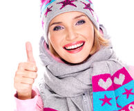 Happy adult girl in winter clothes with thumbs up Stock Photos