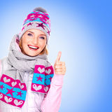 Happy adult girl in winter clothes with thumbs up Royalty Free Stock Photos