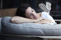 Happy adult latin woman sleeping outdoors Stock Photography