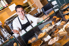 Happy adult man selling tarts and sweet pastry Stock Photography