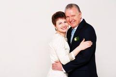 Happy adult married couple in studio Stock Image