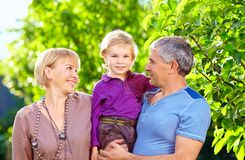 Happy adult parents with small son Stock Photo