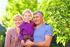 Happy adult parents with small son Royalty Free Stock Photo