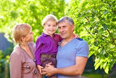 Happy adult parents with small son Royalty Free Stock Image