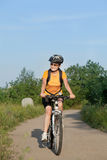 Happy adult  woman cyclist Royalty Free Stock Photography