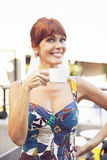 Happy adult woman drinking coffee. Happy adult woman having a coffee Royalty Free Stock Photo