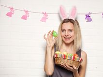 Happy adult woman with with easter eggs Stock Photography