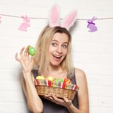 Happy adult woman with with easter eggs Stock Images